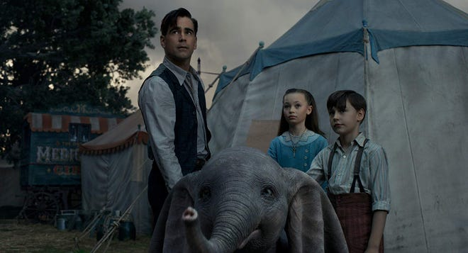 "Colin Farrell, Nico Parker and Finley Hobbins in ""Dumbo."""