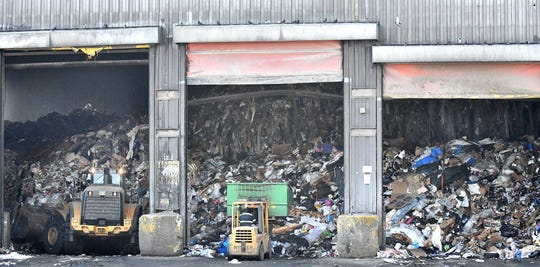 Waste is unloaded from trucks as it starts the process at Detroit Renewable Energy. The incinerator receives more than 3,000 tons of garbage daily.