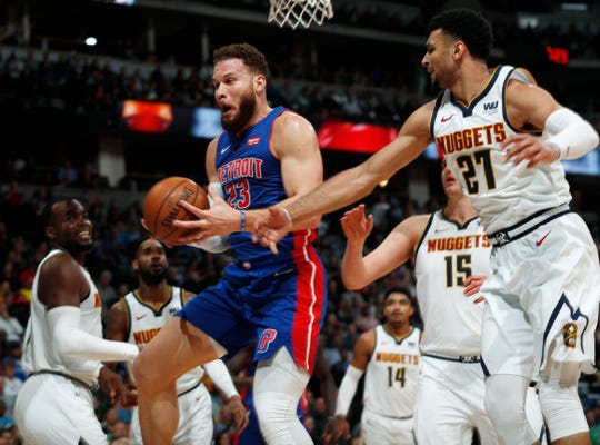 Detroit Pistons forward Blake Griffin, left, pulls in a rebound as Denver Nuggets guard Jamal Murray defends in the first half.