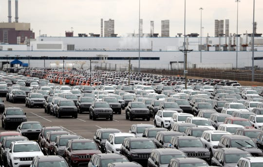 Jeep vehicles are parked outside the Jefferson North Assembly Plant in Detroit, Tuesday, Feb. 26, 2019. The city of Detroit will acquire 14 acres of leased land from the Great Lakes Water Authority in its effort to deliver 200 acres to Fiat Chrysler Automobiles NV for its $2.5 billion plant expansion on the city's east side.
