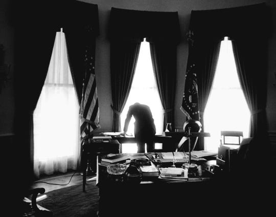 The President at work in the Oval Office, January, 1961.
