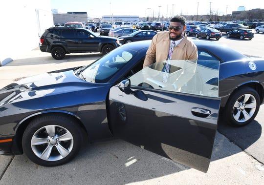 Dwayne Kory Davis Jr. last week checks out a 2017 Dodge Challenger SXT at a Southfield dealership.
