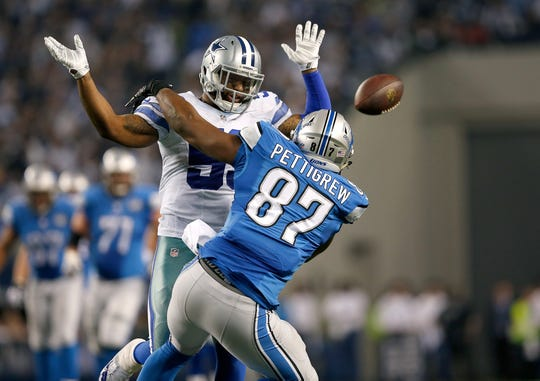 Dallas Cowboys outside linebacker Anthony Hitchens (59) breaks up a pass intended for Detroit Lions tight end Brandon Pettigrew (87) during an NFL wild card playoff football game at AT&T Stadium on Sunday, January 4, 2015 in Arlington, Texas. Pass interference was called, then reversed on the play. Dallas won 24-20.