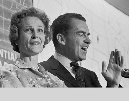 Richard Nixon, with wife Pat, concedes the presidential race to John F. Kennedy in 1960.