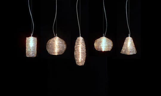 April Wagner of Epiphany Glass in Pontiac has unveiled a new line of handmade glass light fixtures.