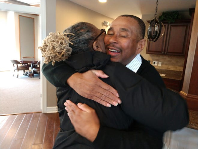 """Abner Hines hugs a loved one. """"It's a fallacy to think it takes 20 or 30 years for a man to change his life around,"""" he says."""