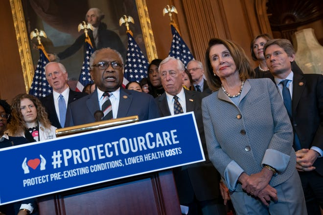 Speaker of the House Nancy Pelosi, D-Calif., joined at left by Majority Whip James E. Clyburn, D-S.C., leads an event to announce legislation to lower health care costs and protect people with pre-existing medical conditions, at the Capitol in Washington, Tuesday, March 26, 2019. T