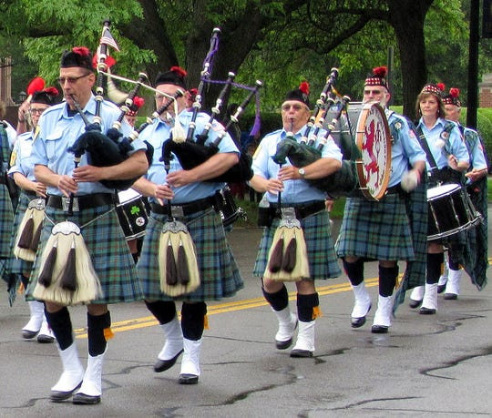 The Caledonian Highlanders Pipe & Drum Band marches during  an Elmira Memorial Day parade.