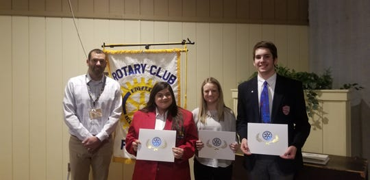 Scott Lang, Rotary Club Immediate Past President, stands with the Students of the Mondah for February. Left to right are, Kalin McCann from Vanguard Career Center, Cassidy Price from Fremont Ross High School and Dalton Ewing from Fremont St. Joseph Central Catholic High School.