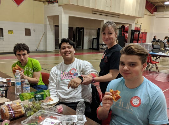 School nurse Angela Reineck (standing) checks on Luciano Alvarez after donating blood at the PCHS Red Cross Bloodmobile on March 20.  Enjoying snacks after donating are Chase Barton (left) and Riley Damschen (right).