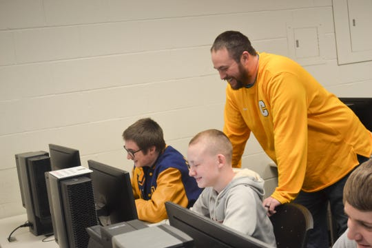 Jerry Phillips shares a light moment with his STEM students at Clyde High School.