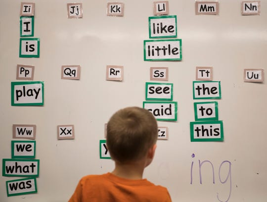 "Kindergartener Drexler Martin picks out the words for the how-to book he's writing from the ""word wall"" on Wednesday, March 27, 2019, at Riffenburgh Elementary School in Fort Collins, Colo."