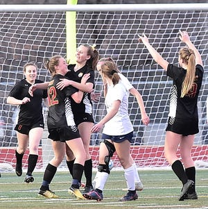 Rocky Mountain High School's girls soccer team, shown celebrating a goal in a Tuesday, March 26, win over Poudre at French Field, and Fort Collins will host games Tuesday in a doubleheader at French Field. Fort Collins faces Horizon at 4:30 p.m, while Rocky Mountain takes on Fairview at 6:30 p.m.