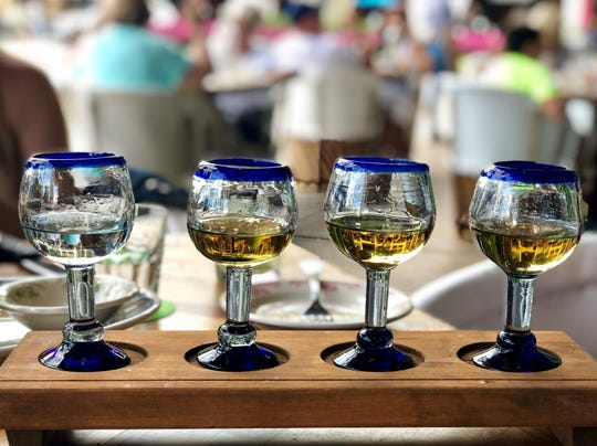 A tequila flight ($28) from Rocco's Tacos starts with Maestro Dobel silver, the lightest sampling on the left. Next are the Chinaco reposado, Riazul anejo and the rich, oaky Cazadores extra anejo.