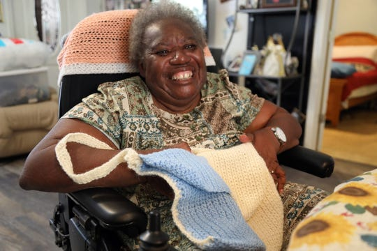 Violence against disabled people kept Martha Clemmons from school int he 1950s, she recounted at home in Fort Myers, but she learned skills including data entry and knitting, which she loves, at LARC,, a non-profit dedicated to enhancing the lives of people with disabilities.