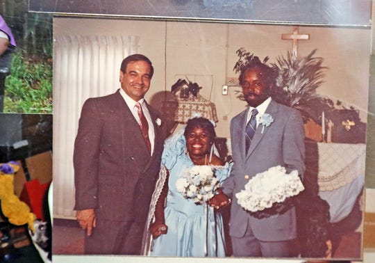 Pictures frame a living room wall at the home of Eddie and Martha Clemons. Shown, the happy couple on their wedding day.