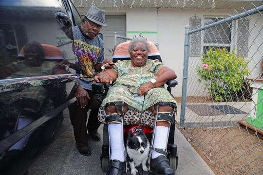 Eddie and Martha Clemons prepare for an outing from their home in Fort Myers in a car adapted for Martha's wheelchair.