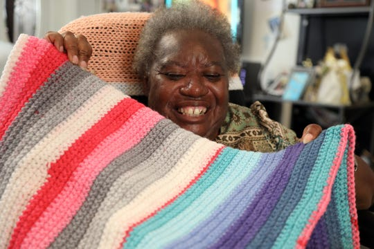 Violence against disabled people kept Martha Clemons from school int he 1950s, she recounted at home in Fort Myers, but she learned skills including data entry and knitting, which she loves, at LARC,, a non-profit dedicated to enhancing the lives of people with disabilities.