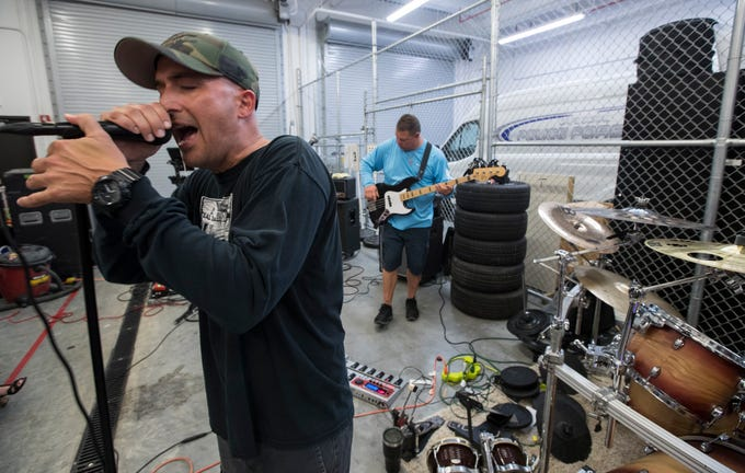 Walt Herman, a member of the band Signal 3, sings a song during a rehearsal session Tuesday, 3/26/16 at the Cape Coral Police Department's headquarters. The Band members also include: Tom Eberhardt, guitar; John Howes, bass; Chad Hartzell, guitar; Mick Jahaaski, drums; Steve Barnes, guitar; and Gabrielle Fernandez, vocals. All band members are local law enforcement officers.