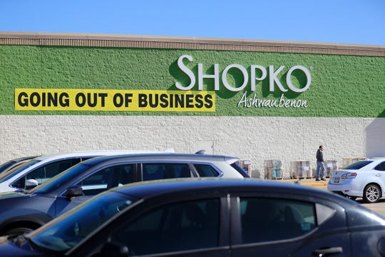 The business exit signs were posted last month outside of Shopko in Bay Park Square in Ashwaubenon.