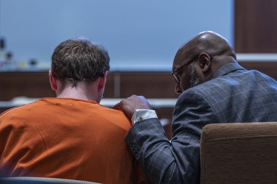 Public defender Richard Jones, right, comforts Jake Patterson after he pleaded guilty Wednesday in Barron County Circuit Court to kidnapping 13-year-old Jayme Closs and murdering her parents, James and Denise Closs, at their home in October 2018.