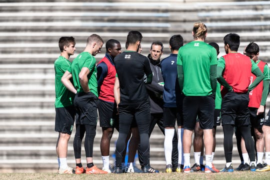 John Harkes, coach of Greenville Triumph, Greenville's new professional USL soccer team, talks to his team during their practice at Bob Jones University, Mar. 27, 2019.