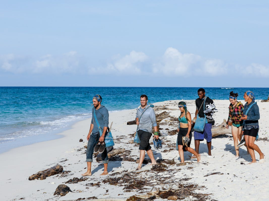 "Chris Underwood and fellow castaways leaving Extinction Island on ""Survivor: Edge of Extinction."""