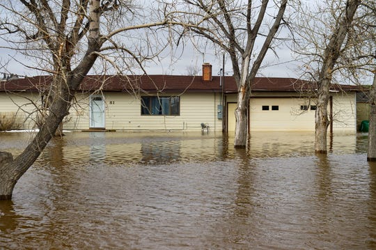 Floodwater surrounds a home in Gibson Flats Wednesday.