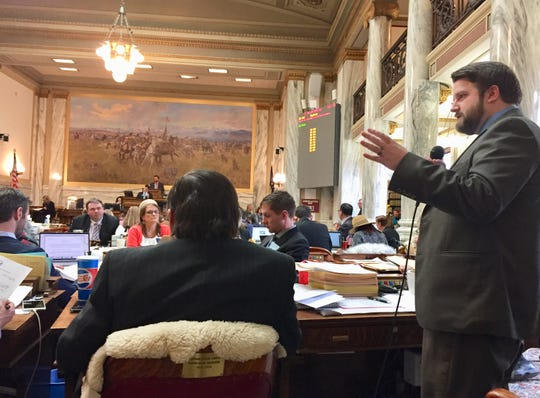 Rep. Mike Hopkins, R-Missoula, talks on the House floor Wednesday about HB 652.