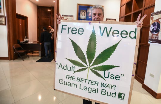 August Fest, Merizo resident and sole member of Guam Legal Bud, displays a sign in the lobby of the Guam Congress Building to express his support of Bill 32, in Hagåtña on Wednesday, March 27, 2019. Bill 32 is a measure before the lawmakers to legalize recreational use of marijuana by adults