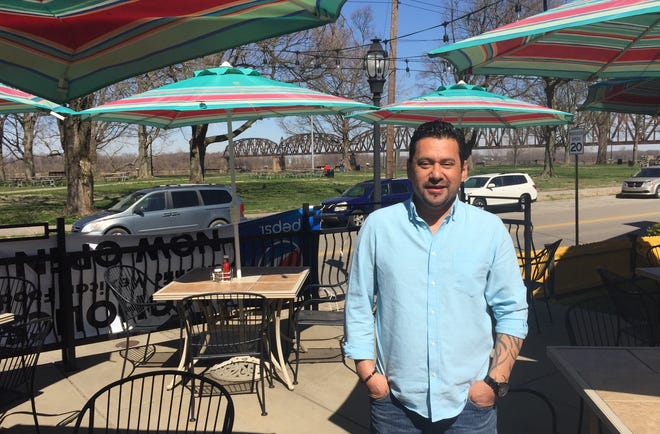 Antonio Ragazzo poses on the patio of his new Henderson restaurant. He is the owner of The Coyote Mexican Restaurant at 104 N. Water St.