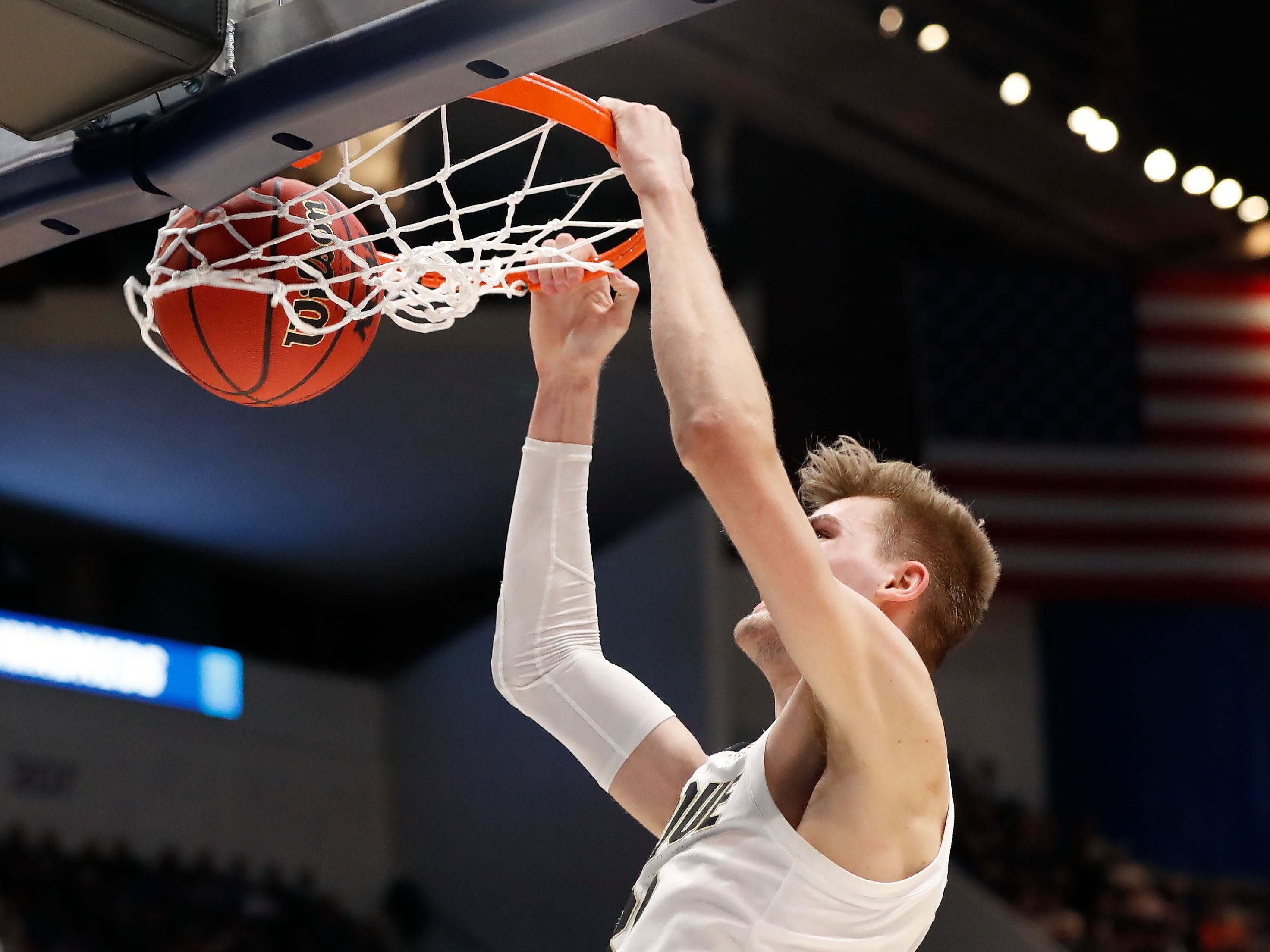 Purdue Boilermakers center Matt Haarms (32) dunks and scores against the Villanova Wildcats during the first half of a game in the second round of the 2019 NCAA Tournament at XL Center.