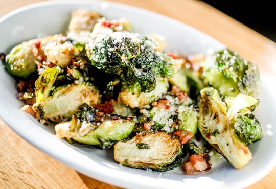 Bud's Brussels Sprouts family style side are in the $3-5 range at the Boathouse Kitchen & Swan Dive, located on Morse Reservoir in Cicero Ind. on Tuesday, March 26, 2019.