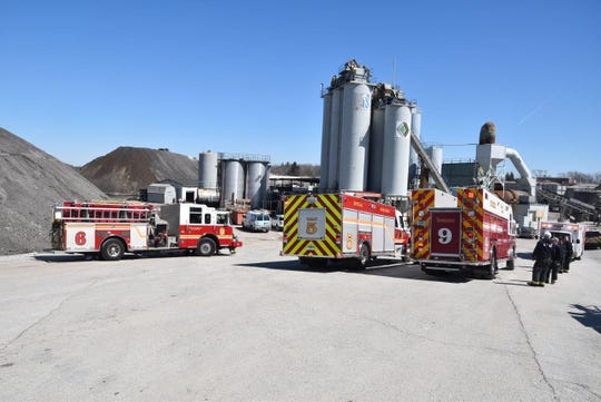 Firefighters from multiple Indiana departments save a man trapped in a gravel silo on East 96th Street.