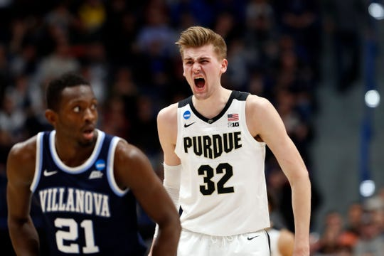 Purdue Boilermakers center Matt Haarms (32) reacts after scoring against the Villanova Wildcats during the first half of a game in the second round of the 2019 NCAA Tournament at XL Center.