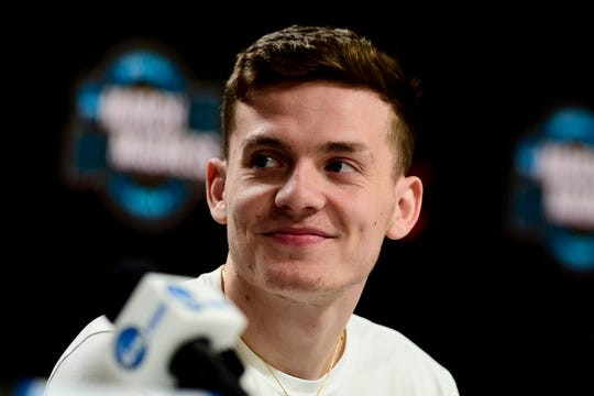 Cavaliers guard Kyle Guy (5) speaks at a press conference during practice for the south regional of the 2019 NCAA Tournament at KFC Yum Center.