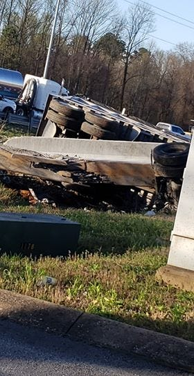 Three drivers walked away without injuries from a Wednesday morning crash that left two tractor trailers overturned near exit 80 on Interstate 40 in Jackson.