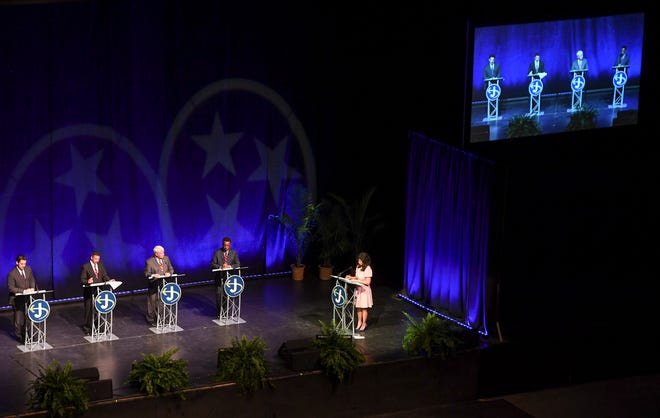 Scott Conger, Mark Johnstone, Jimmy Eldridge and Jerry Woods participate in a  Jackson mayoral forum at the Carl Perkins Civic Center on March 26.