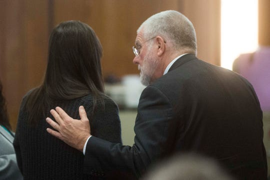 Defense attorney Bob Jolley comforts Shannon Smith as they wait for court to resume in her second-degree murder trial in Union County Criminal Court March 27, 2019.