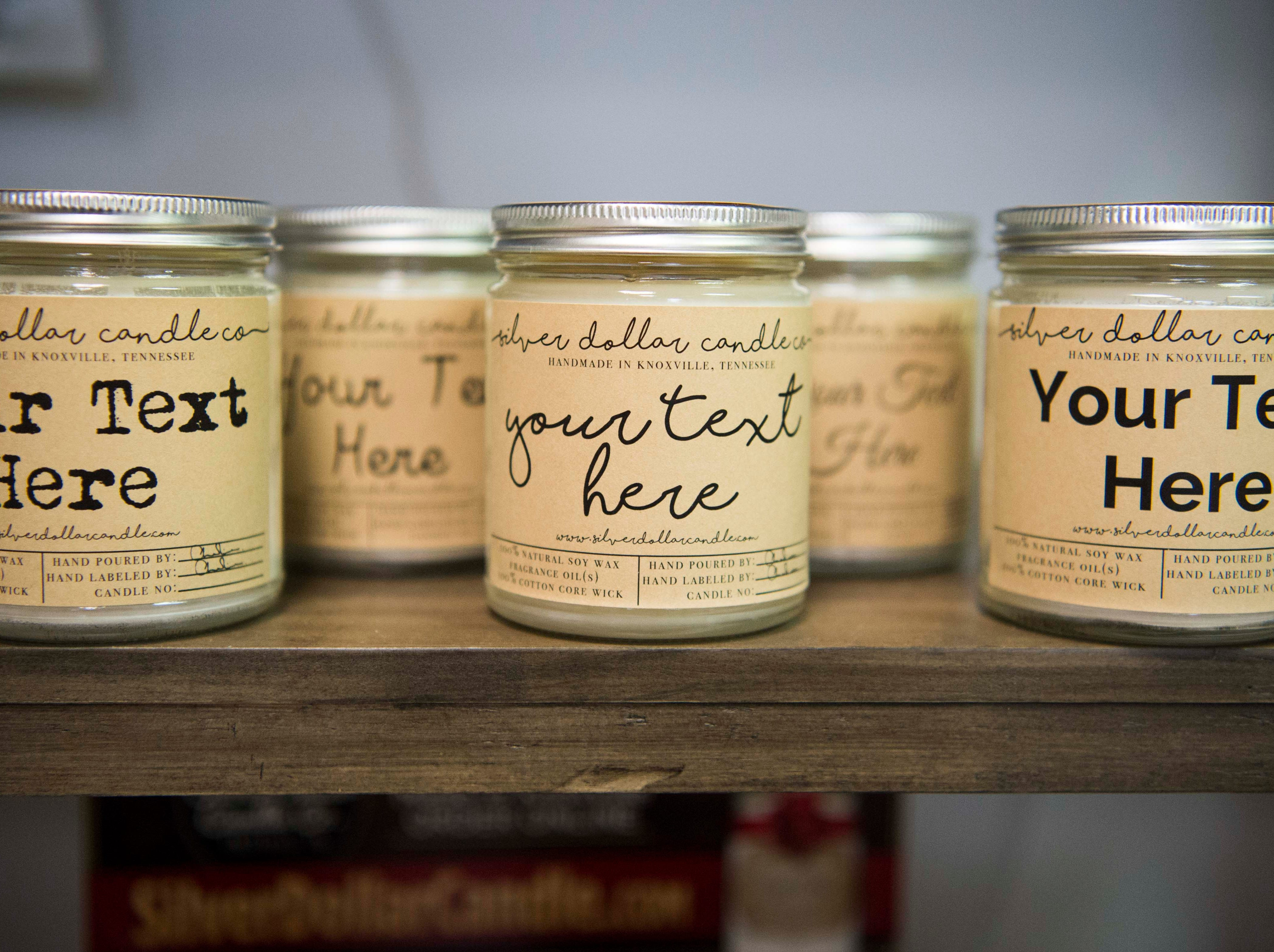 Candles are arranged on shelves at Silver Dollar Candle Co. in Knoxville Tuesday, March 26, 2019. Silver Dollar Candle offers unique soy candles in a variety of scents, and is expanding to offer a make-your-own candle experience in their store.