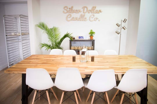 An area for candle making is set up at Silver Dollar Candle Co. in Knoxville Tuesday, March 26, 2019. Silver Dollar Candle offers unique soy candles in a variety of scents, and is expanding to offer a make-your-own candle experience in their store.