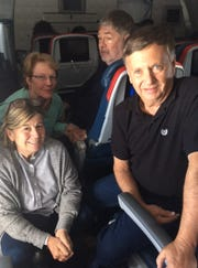 Jamey Kennedy (back left) smiles aboard a plane back to the United States beside with her husband Allan Reiss ( back right) and their friends Laura and Richard Wolfe (front). The four arrived back in the United States late Tuesday night after surviving a harrowing ordeal aboard the Viking Sky cruise ship.