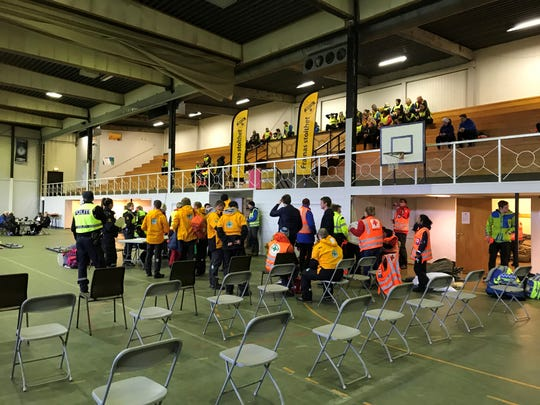 Volunteers wait for helicopters to arrive at an abandoned Brynhallen sports arena near the Hustadvika Bay in Norway. When she saw the Viking Sky stranded in the stormy sea during a walk along the city's docks, Red Cross volunteer Bente Flem quickly organized the relief effort with police and her boyfriend, who is also in the Red Cross.
