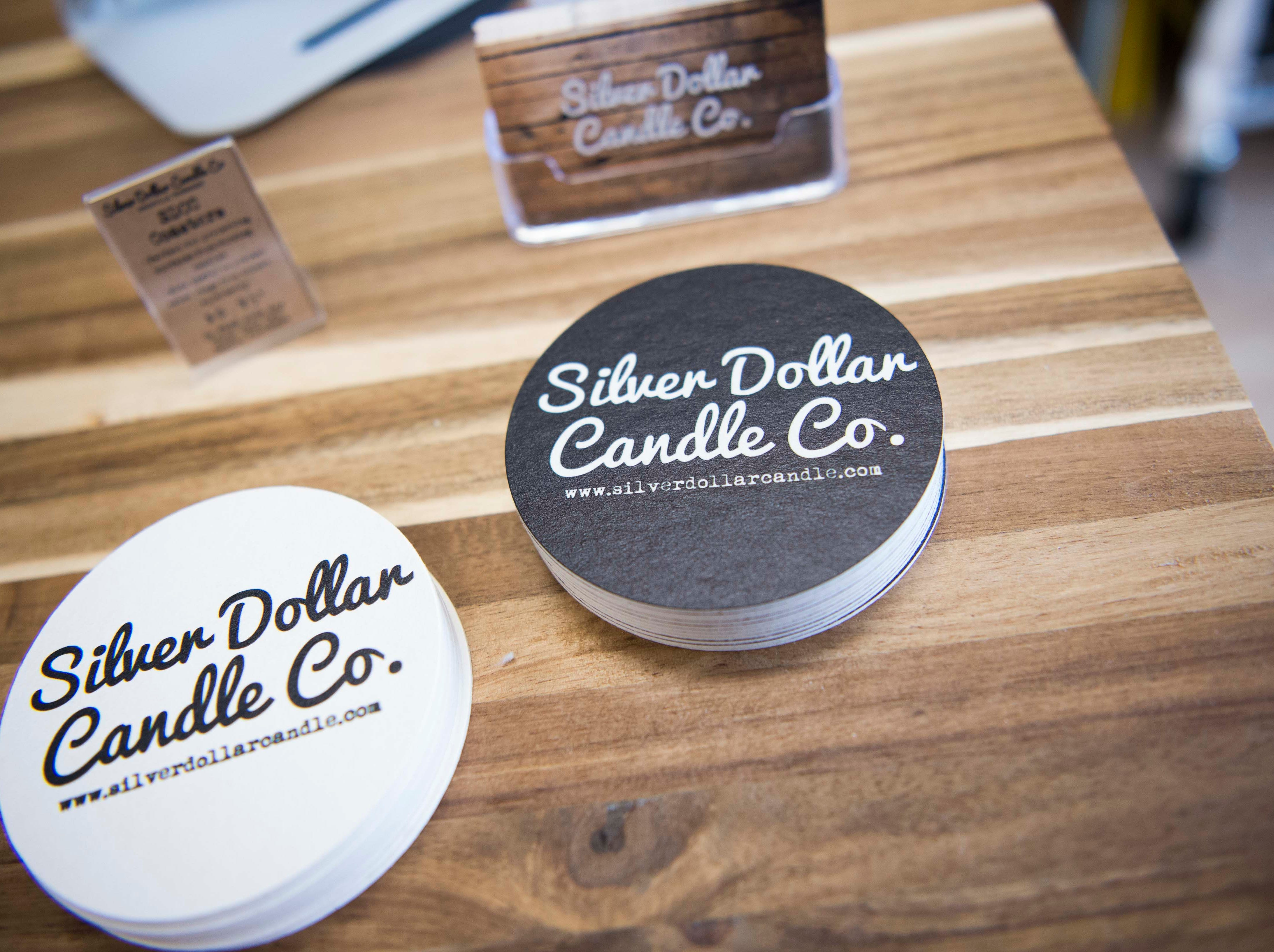 Branded coasters are seen at Silver Dollar Candle Co. in Knoxville Tuesday, March 26, 2019. Silver Dollar Candle offers unique soy candles in a variety of scents, and is expanding to offer a make-your-own candle experience in their store.