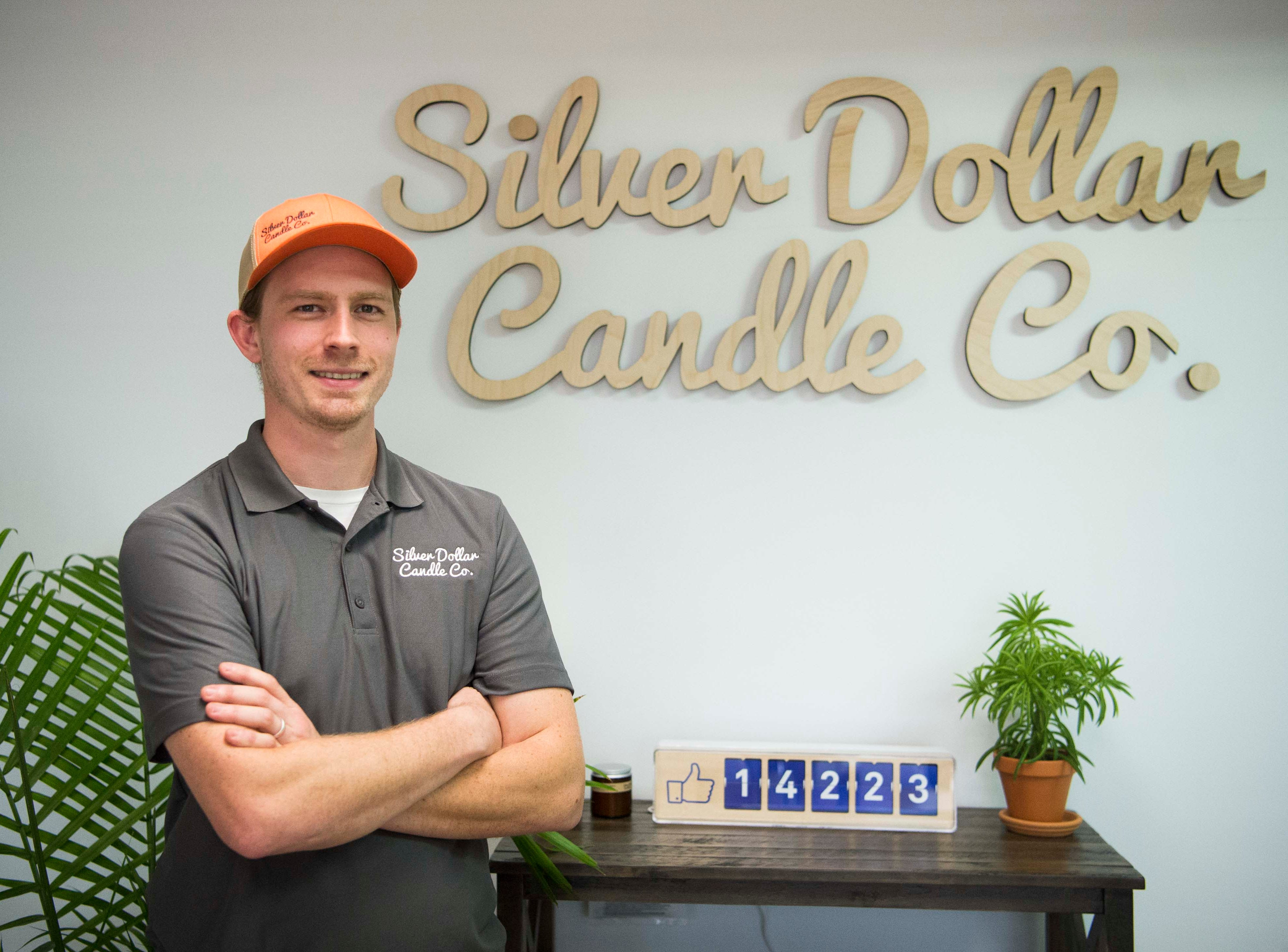 Co-owner Charlie Todd stands in Silver Dollar Candle Co. in Knoxville Tuesday, March 26, 2019. Silver Dollar Candle offers unique soy candles in a variety of scents, and is expanding to offer a make-your-own candle experience in their store.