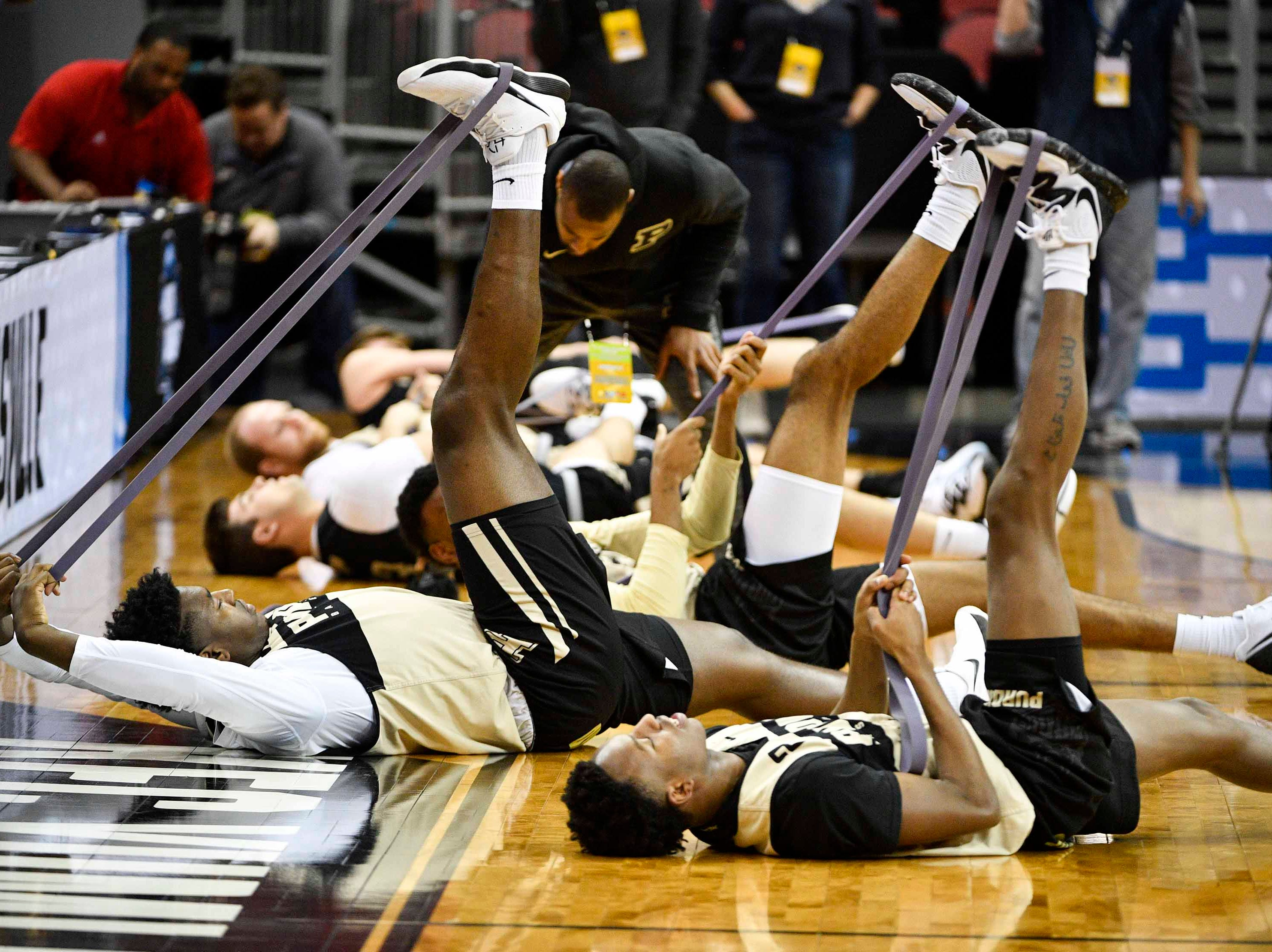 Mar 27, 2019; Louisville, KY, United States; Purdue Boilermakers players stretch during the Purdue Boilermakers practice for the south regional of the 2019 NCAA Tournament at KFC Yum Center. Mandatory Credit: Jamie Rhodes-USA TODAY Sports