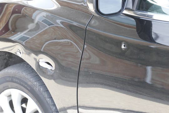 There were at least five bullet holes on the driver's side of the car found Wednesday a Romney Meadows apartment. Police suspect this might be one of two cars involved in the March 15 shooting on I-65.