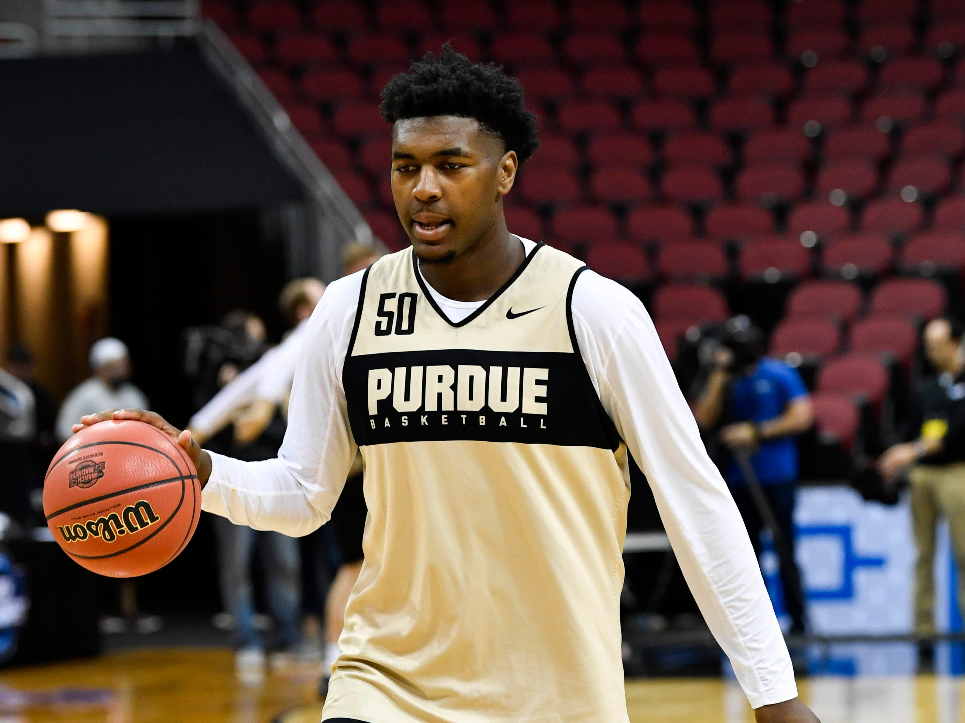 Mar 27, 2019; Louisville, KY, United States; Purdue Boilermakers forward Trevion Williams (50) dribbles during the Purdue Boilermakers practice for the south regional of the 2019 NCAA Tournament at KFC Yum Center. Mandatory Credit: Jamie Rhodes-USA TODAY Sports