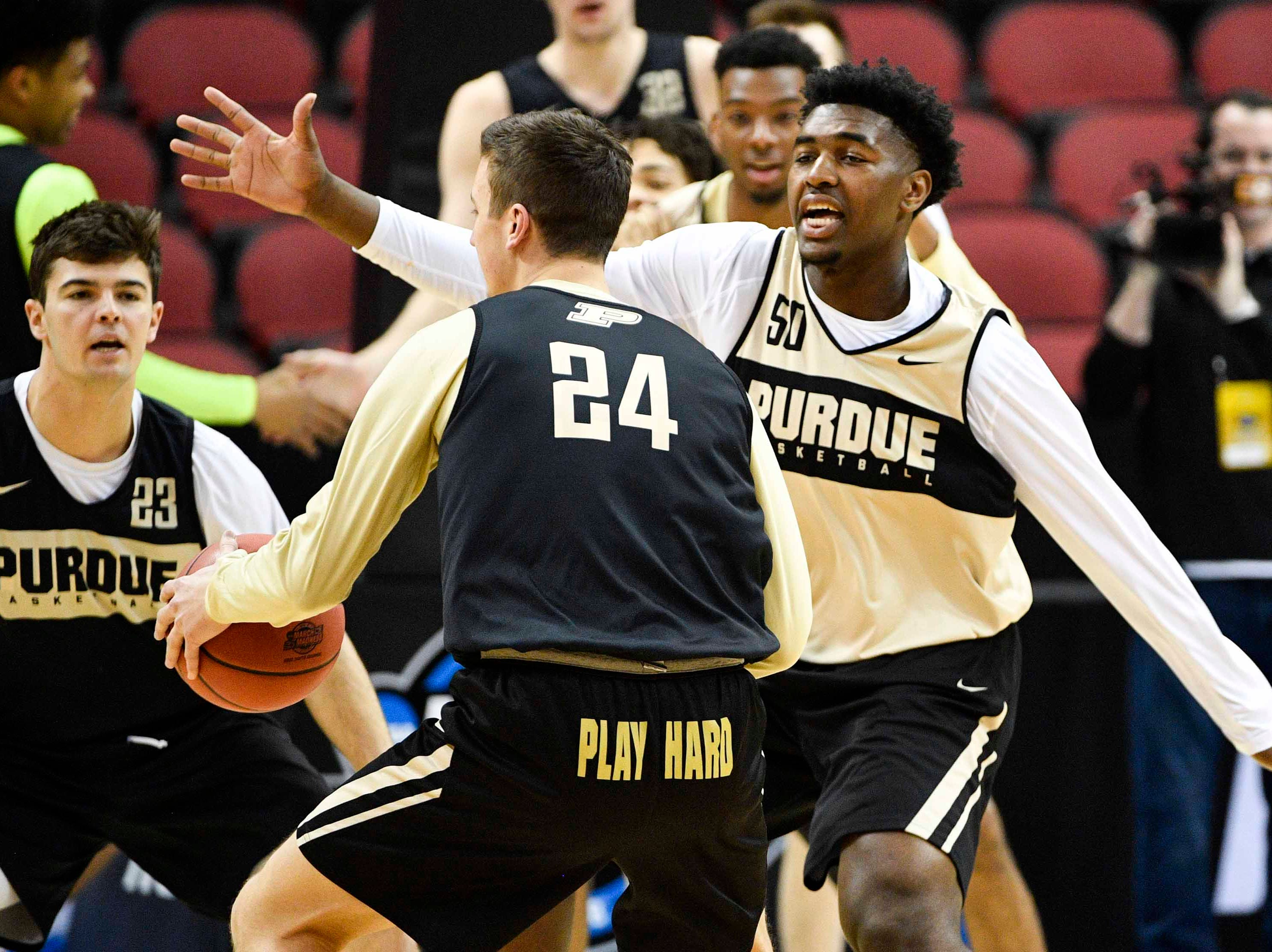 Mar 27, 2019; Louisville, KY, United States; Purdue Boilermakers forward Trevion Williams (50) guards forward Grady Eifert (24) during the Purdue Boilermakers practice for the south regional of the 2019 NCAA Tournament at KFC Yum Center. Mandatory Credit: Jamie Rhodes-USA TODAY Sports