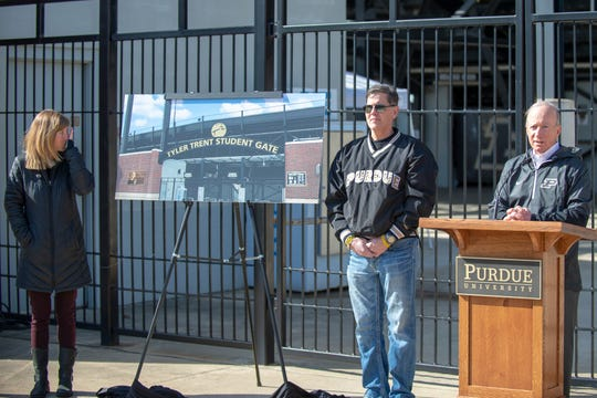 Tony and Kelly Trent (left) listen as Purdue President Mitch Daniels unveils the Tyler Trent Student Gate on Wednesday at Ross-Ade Stadium